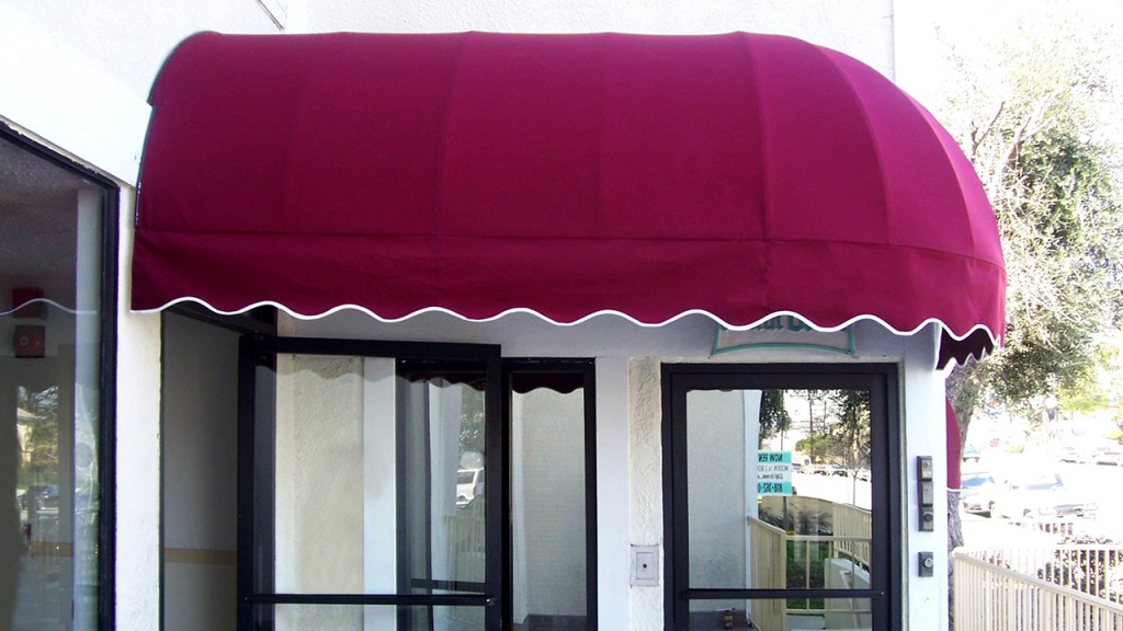 Elongated dome awning over doors