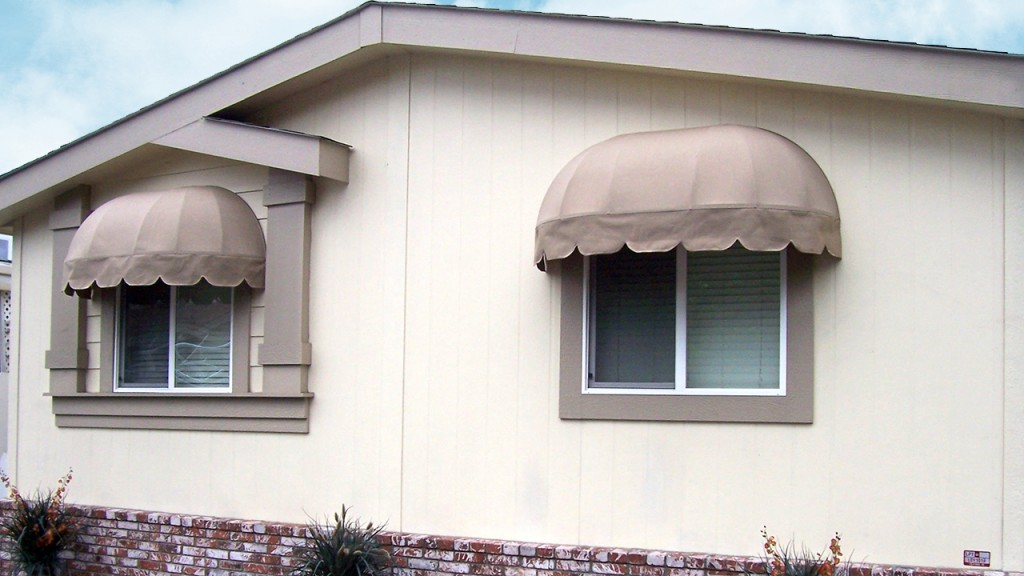 Elongated dome awnings over windows