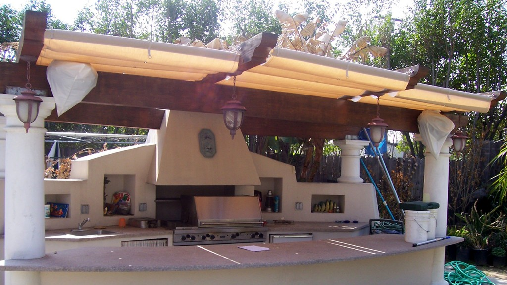 This residential awning creates a lovely barbecue space