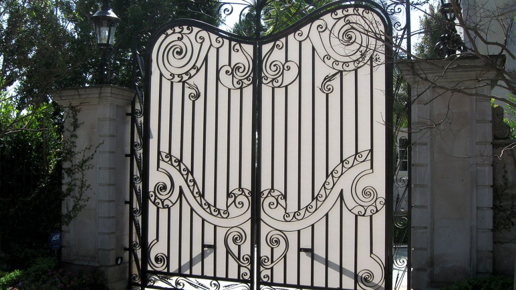 Outdoor privacy screen with ironwork