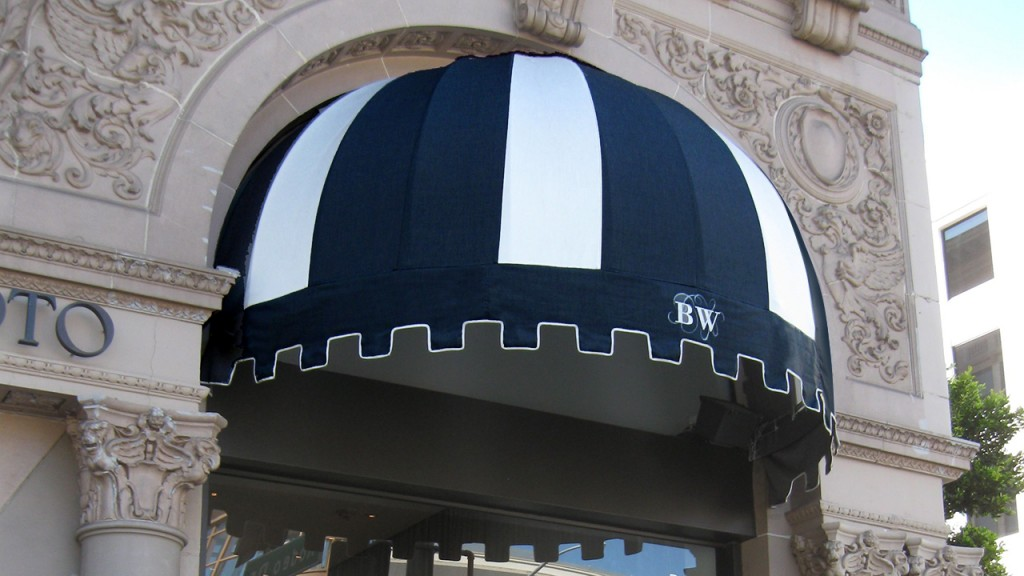 A dome awning customized with a business logo