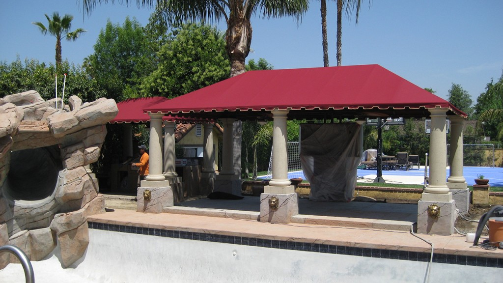A poolside residential awning creates shade and comfort