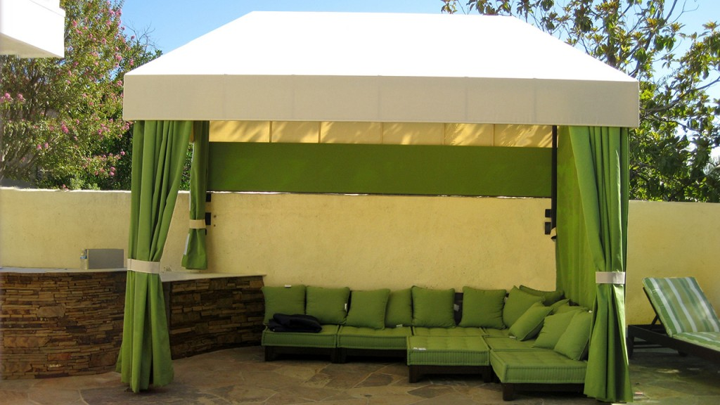 A custom cabana with matching green cushions