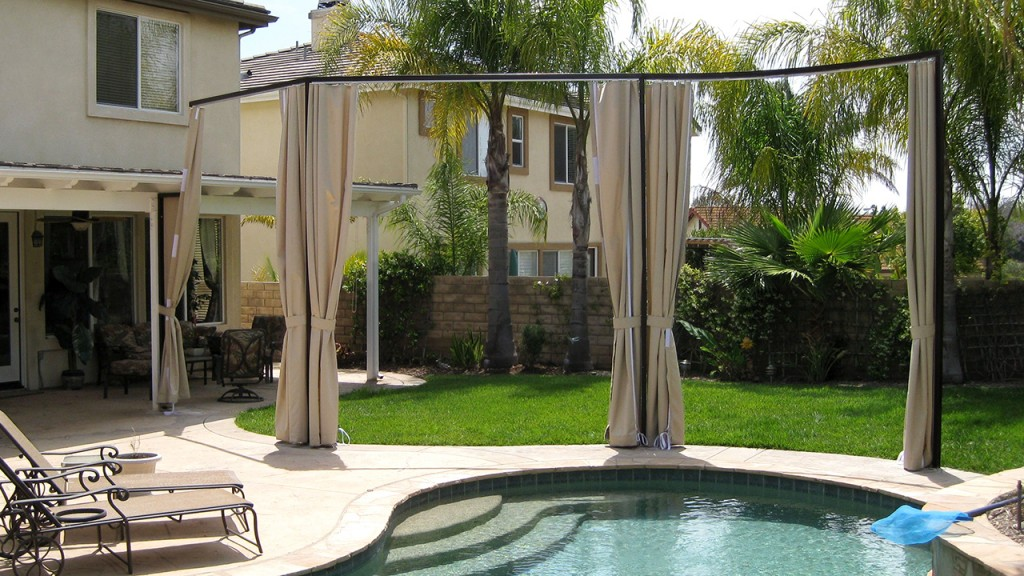 Sliding curtains by pool - open