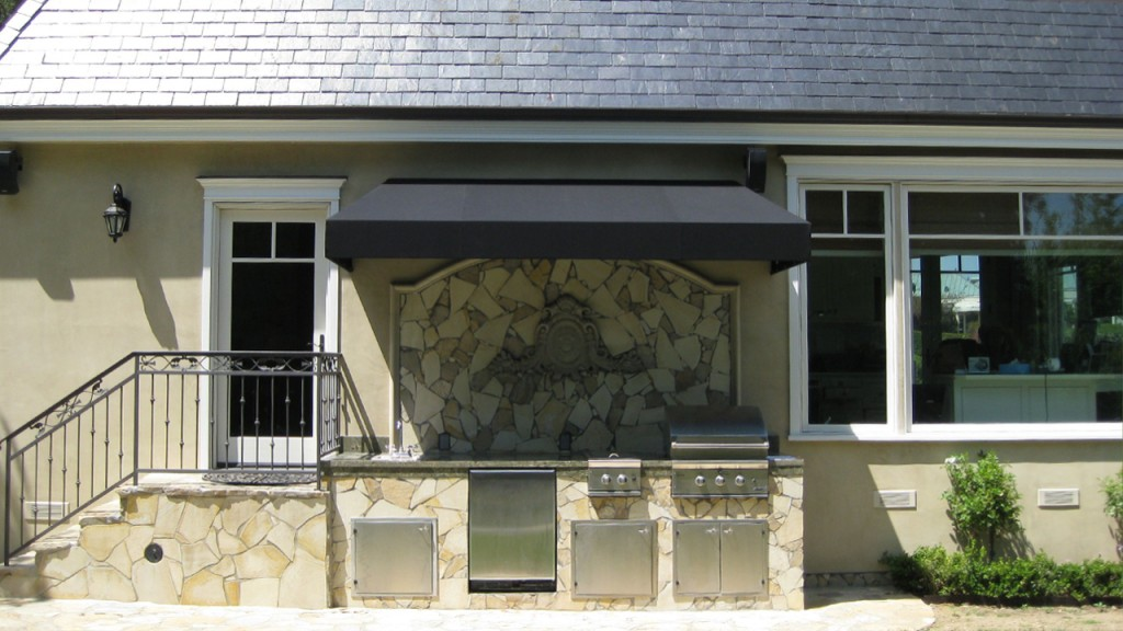 This beautiful barbecue awning was custom made by A World of Awnings