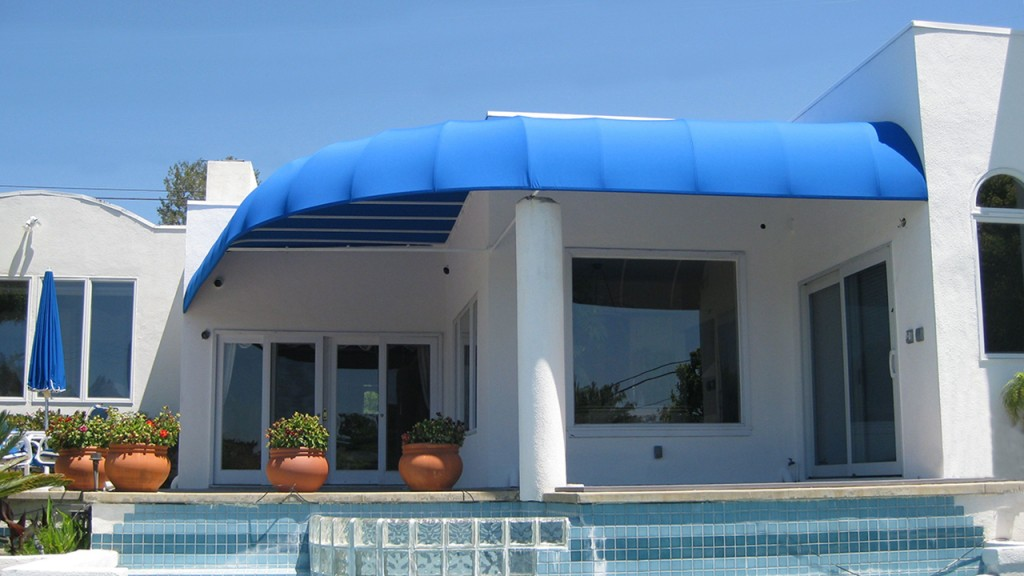 Elongated dome awning by a pool