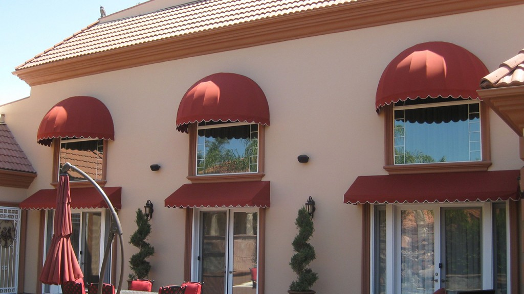 Dome awnings over window