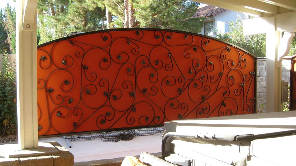 outdoor privacy screen behind ironwork
