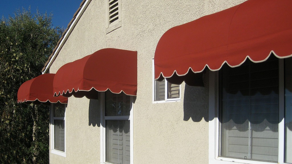 Red convex awnings over windows