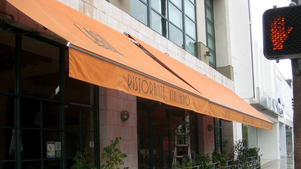 Retractable awning over restaurant patio