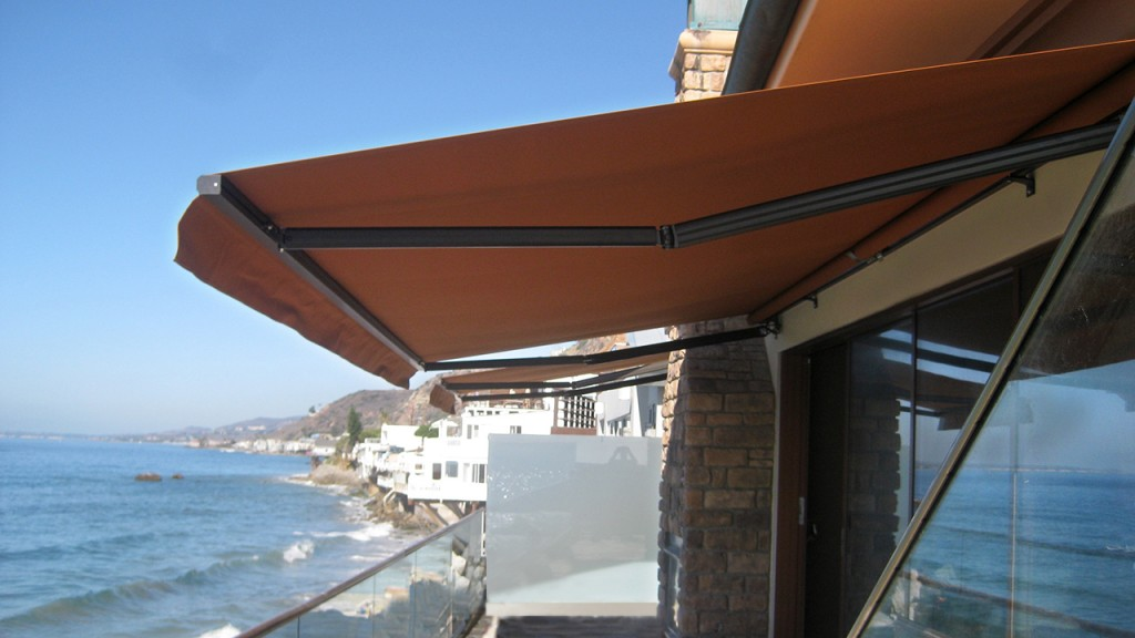 Retractable awning at a beachside home