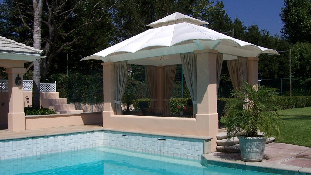 A poolside residential awning keeps you cool in the summer