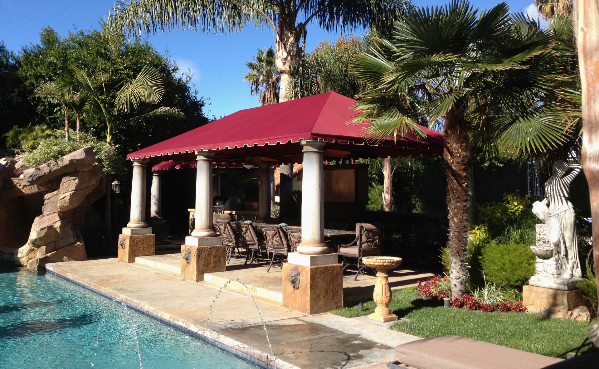 A poolside residential awning adds shade and comfort